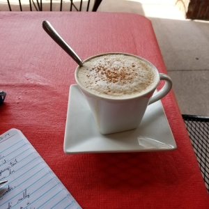cropped-cappuccino-on-table